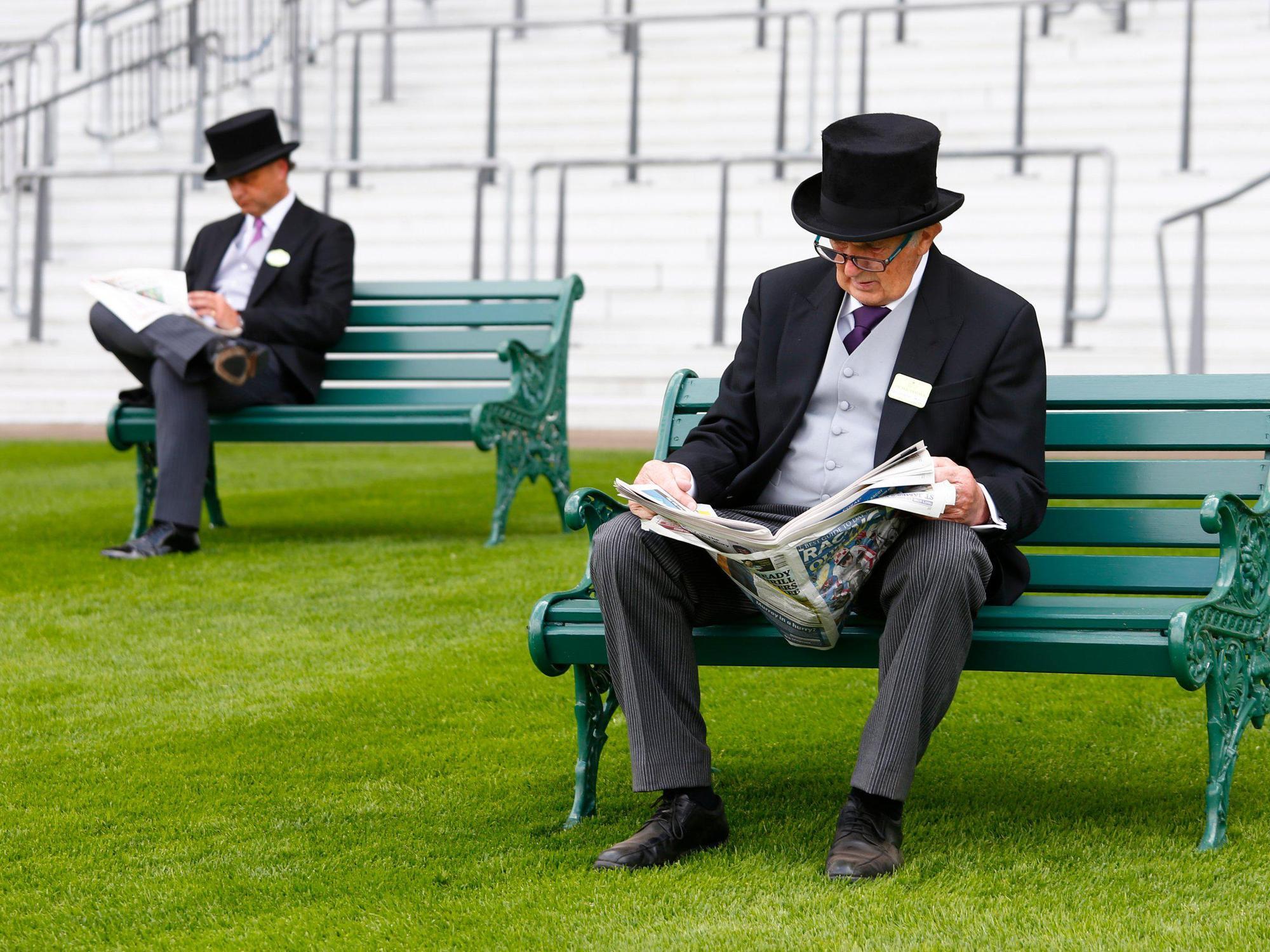 STOCK Horse Racing - Royal Ascot - Ascot Racecourse - A racegoer reads the newspaper,