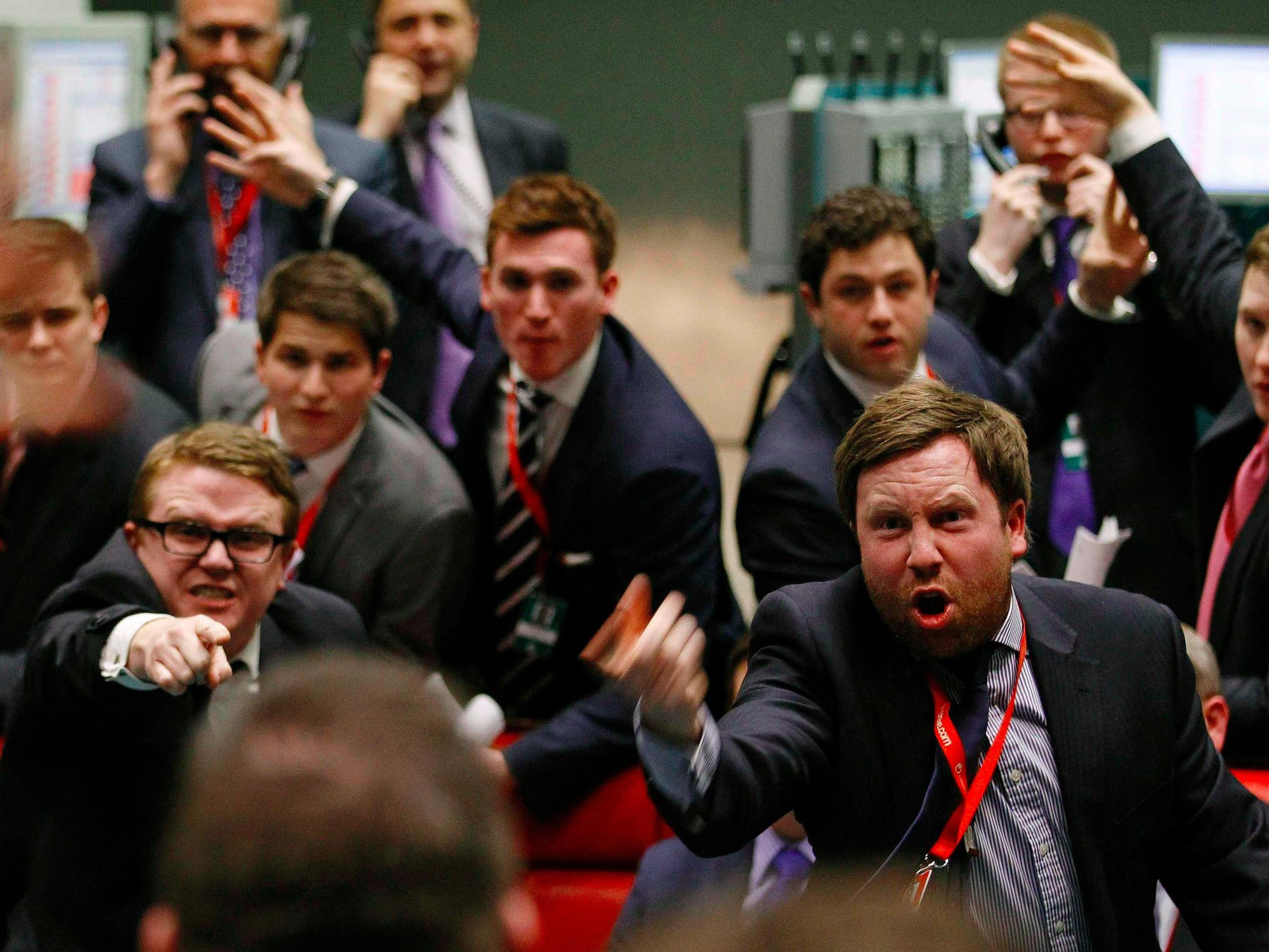 stock Traders and clerks react on the floor of the London Metal Exchange in the City of London February 14, 2012.